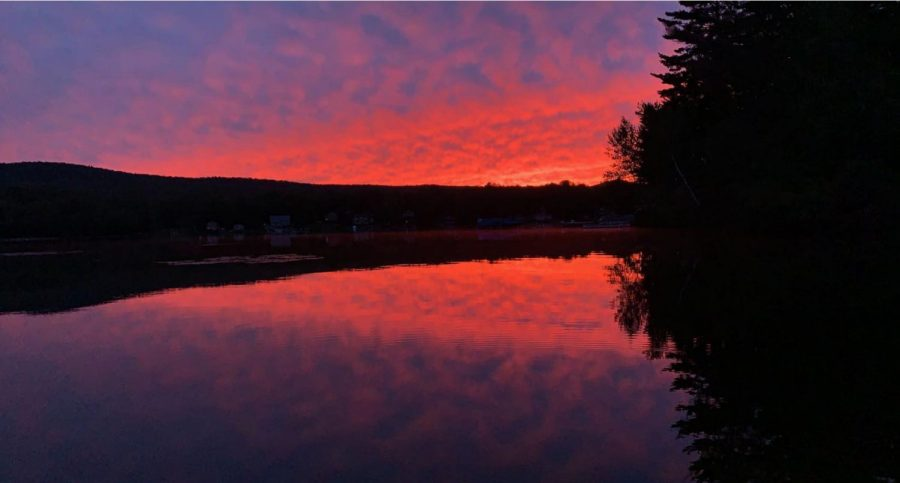 On September 29, on Lake Groton, a beautiful sunset reflected off the flat, calm water.