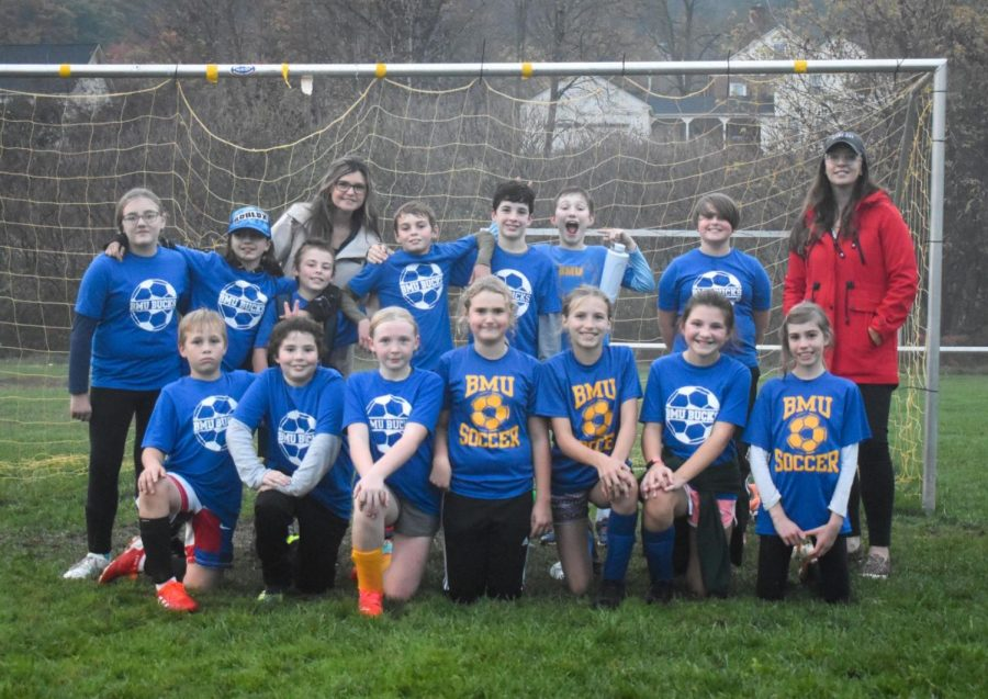 Coached by Samantha Gandin and Danielle Scott, the BMU 5/6 soccer team played their last game of the season on October 21st. I have enjoyed watching the players grow in skill and character, says Coach Scott.